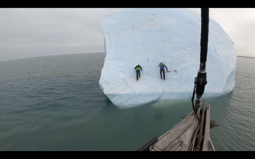 2 Dudes Have Fun Climbing an Iceberg… Until It Flips Over